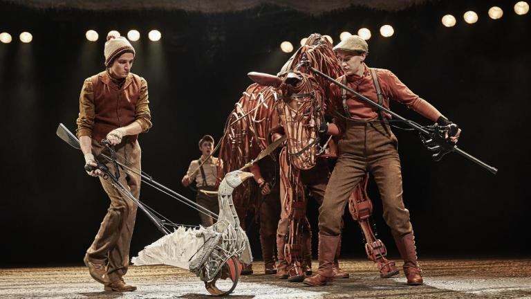 War Horse production image 2019 cast with goose and Joey puppets