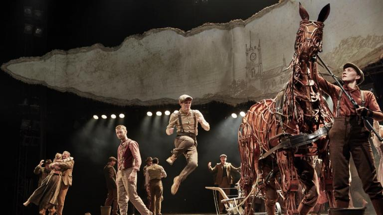 War Horse production image with 2019 cast members and the Joey puppet