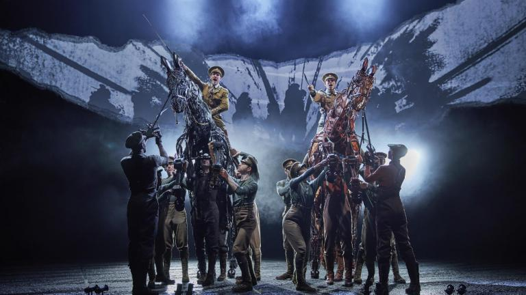 War Horse production image 2019 cast with Topthorn and Joey puppets and teams, ready to charge into battle