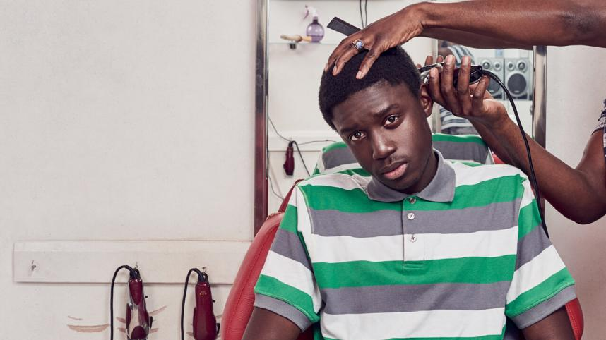 Barber Shop Chronicles - photo of a young man having his hair clipped