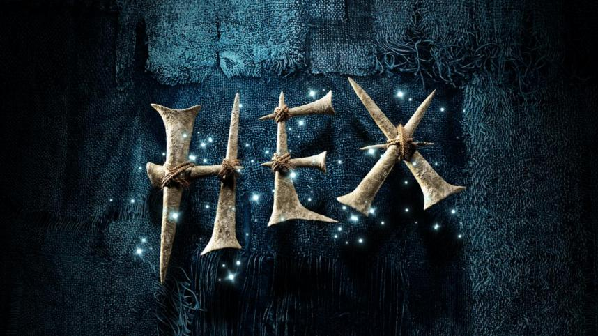 Hex poster image - the Title spelt out in what looks like bones, tied together with rope, the letters surrounded by small lights, against a backdrop of black sacking material