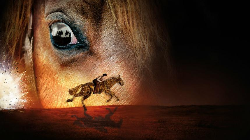 War Horse production image with two horse puppets and their puppeteers