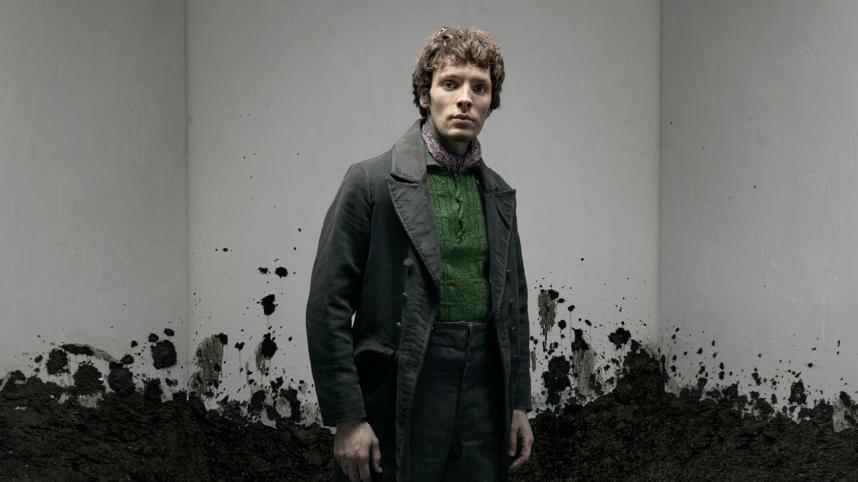 Translations poster, with Colin Morgan in rough, mud-splattered clothes