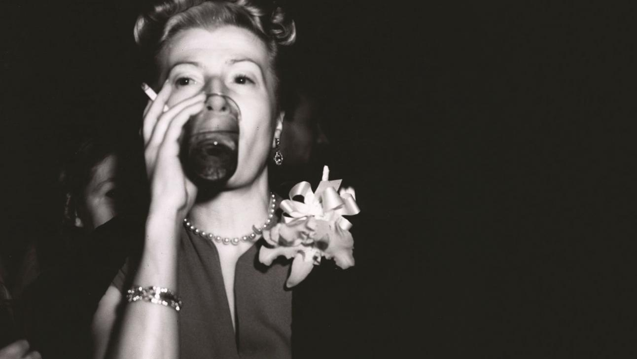 Absolute Hell - b&w photo of a woman drinking