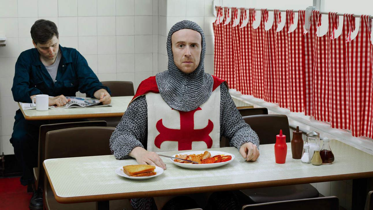 Saint George and the Dragon photo of John Heffernan in chainmail and tabard in a greasy spoon