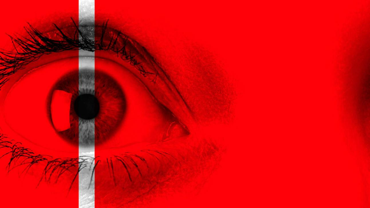 The Tell-Tale Heart - close-up photo of an eye, in red and black, with a thin grey-scale strip bisecting the pupil
