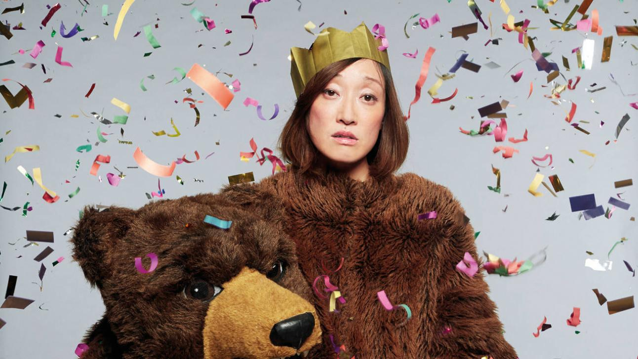 The Winter's Tale - photo of Gabby Wong in a bear suit (bear head in hands)