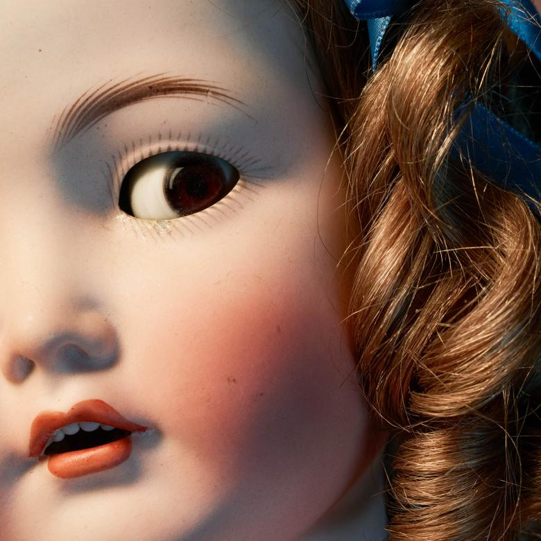 John - close up photo of a doll's head