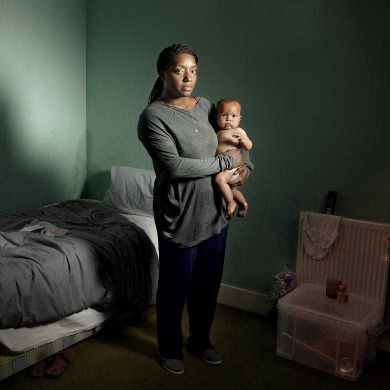 LOVE - photo of a mother and child in an anonymous room
