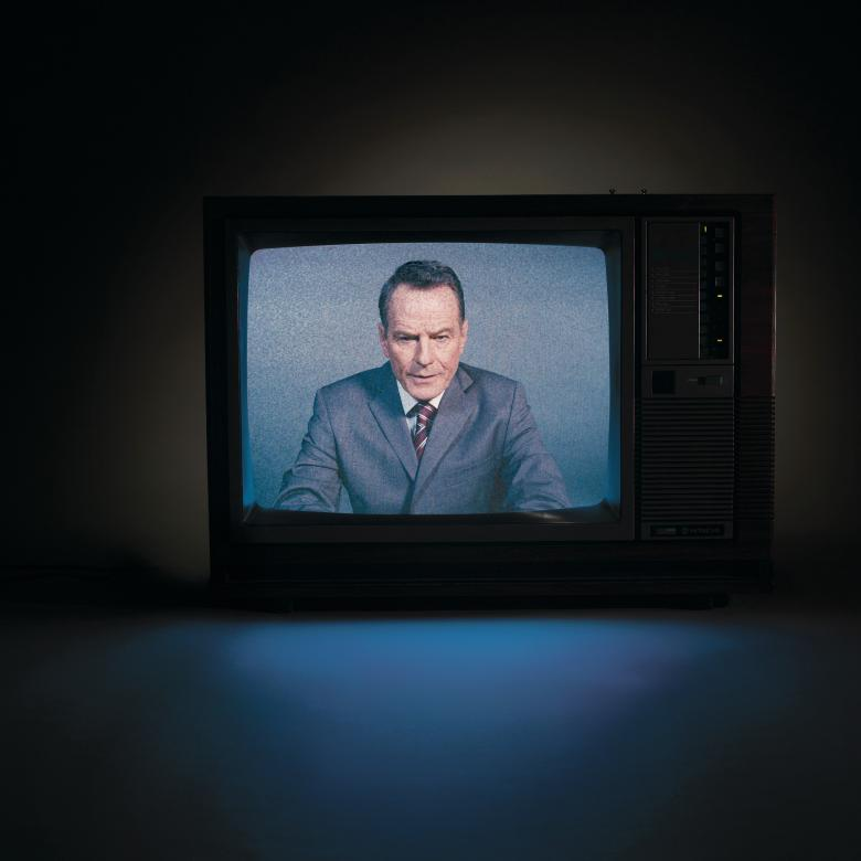 Network - photo of Bryan Cranston on a TV screen