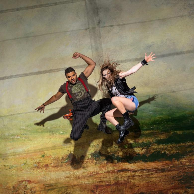 Wuthering Heights poster with Ash Hunter and Lucy McCormick wearing contemporary outfits, jumping