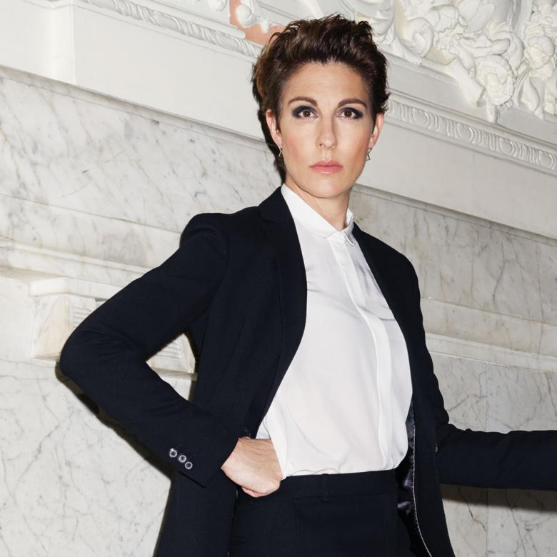 Twelfth Night with staged photo of Tamsin Greig in a dinner suit on a marble stairway
