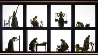 Image of matrons doing housework. The set is split into panels and they are stood in each one.