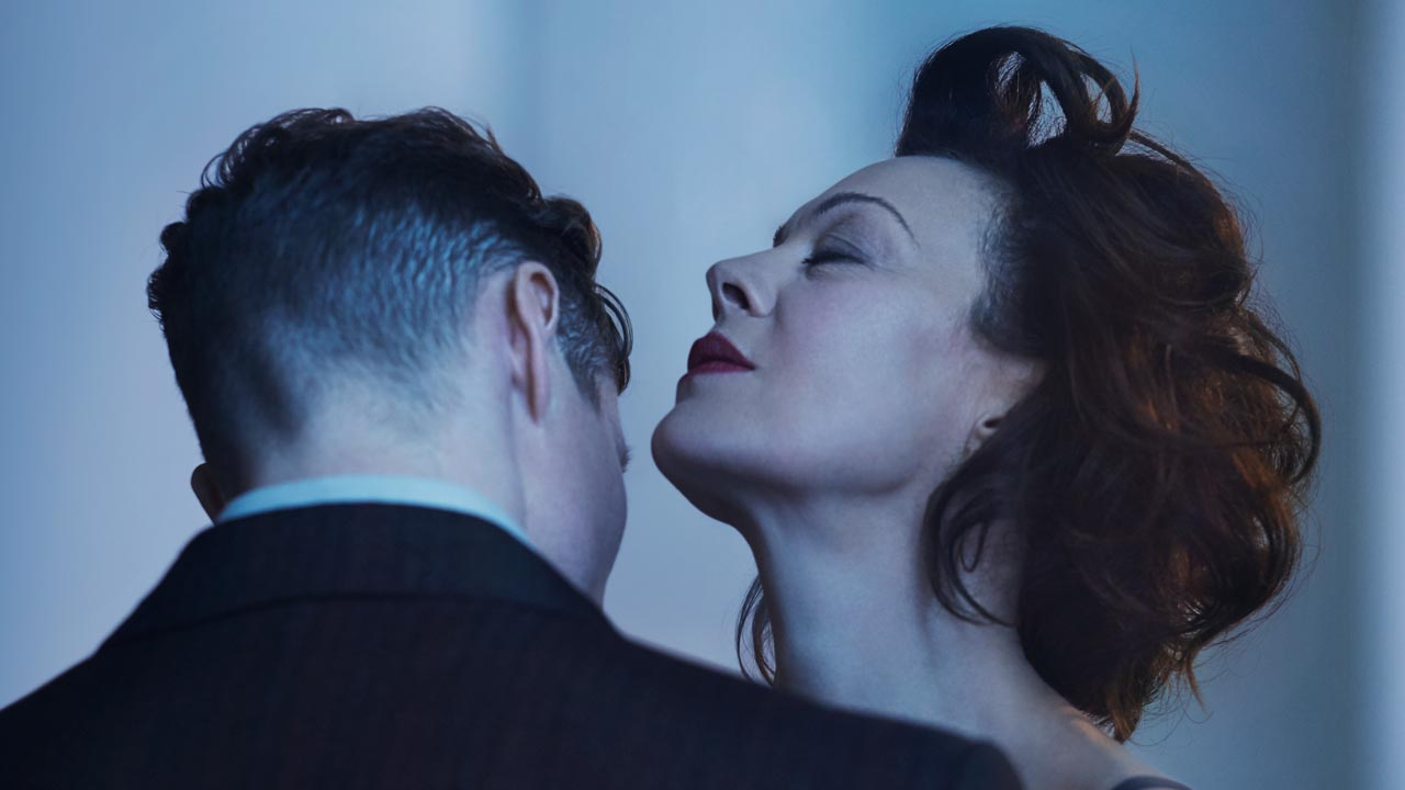 The Deep Blue Sea poster image with Helen McCrory an a young man