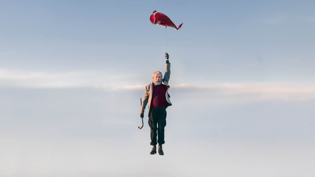 Under Milk Wood - a character being borne into the sky by a strange fish-shaped balloon